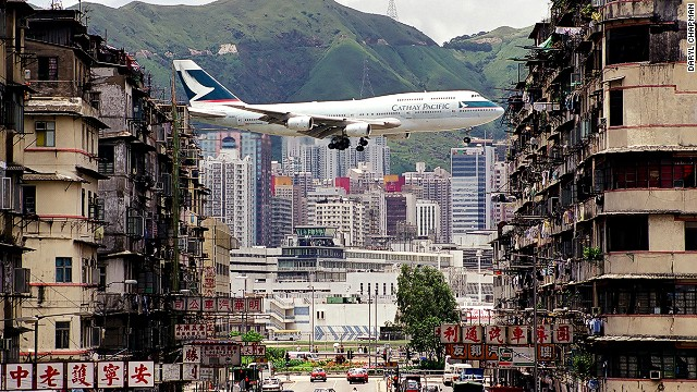 Iconic scene from Kai Tak International Airport -- a Cathay Pacific jet between apartment buildings in Kowloon City.