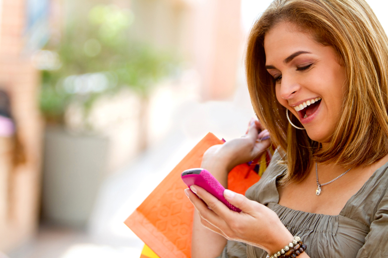 Shopping woman texting