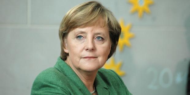 德国总理及国际经济机构领导人捍卫全球贸易合作